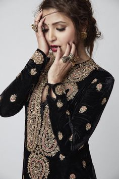 Anushka Sharma looking heaven on earth in this black and gold velvety embroidered Sabyasachi outfit.