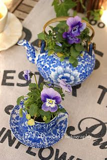 I LOVE blue and white porcelain filled with violets or pansies.  I especially like the brass handle on this teapot.