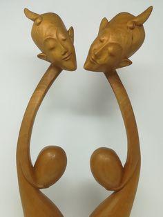 Balinese wooden carvings representing the myth of Dewi Gadru by foundandseekvintage on Etsy