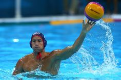 Peter Varellas of the United States throws in the men's preliminary round match with Montenegro