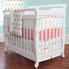 Coral and Teal Arrow Mini Crib Bedding by Carousel Designs.