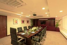 A state of the art Board Room at Country Inn & Suites By Carlson, Mysore equipped with the latest technology and an apt location to hold all your business meetings.