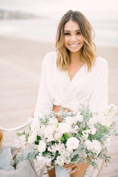 Bachelor contestant Sarah Vendal with summer bouquet of lilac, sweet pea and lisianthus by Compass Floral. Design & Planning // Events by Talissa Photographer // Garrett Richardson #gardenromantic #sandiegoweddingflorist #orangecountyflorist #palmspringsflorist #ojaiflorist #bridalbouquet #bridesbouquet #bridalflowers #sarahvendal #bikesandflowers #beachpicnic #majolicasprayrose #blushandivorybouquet #sweetpeabouquet