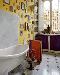 An eclectic gallery wall of small objects and framed artwork in a bathroom - Unique Bathroom Ideas & Decor