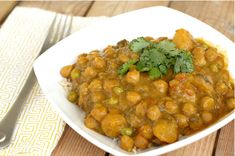 Crock pot butternut squash and chick pea curry.  I subbed green beans for the peas and no thank you to the cilantro (soap!)  Great Dish over rice.