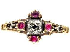 Georgian Mine Cut Ruby and Diamond Ring Georgian (1714-1830) This is a rare and very delicate early Georgian ring, circa 1720. It has four rubies with a central old mine cut diamond. The 18ct gold shank is absolutely original with a spiral twist section at the back.