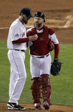 Boston Red Sox catcher David Ross talks to starting pitcher John Lackey during the second inning of Game 6 of baseball's World Series against the St. Louis Cardinals Wednesday, Oct. 30, 2013, in Boston. (AP Photo/Charlie Riedel)