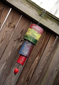 Tin Can Wind Chimes  not sure how musical these would be but a fun project for the kids & a way to decorate a corner of the year