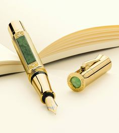 "Special Limited Edition Pen of the year 2015  - The luxurious Special Edition of the ""Sanssouci, Potsdam"" Pen of the Year combines 24-carat gold plating with gemstone workmanship of extraordinary refinement. The barrel is decorated with four beautifully designed Silesian serpentines. A rare chrysoprase crowns the cap of the plunger-type fountain pen."