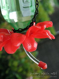 hummingbird feeder from bottle and plastic spoons. This would be a fun project to do with older kids!