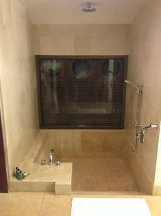 sunken bath tub with rain shower
