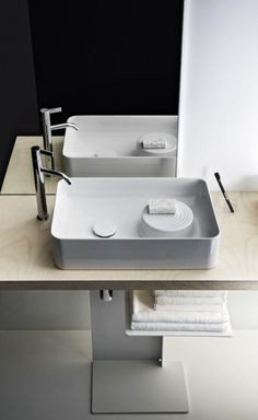 Patented by Swiss manufacturer Laufen, SaphirKeramik is a super-strong ceramic material that can be shaped into impossibly thin geometric forms (think porcelain without the fragility). Laufen brought Munich-based designer Konstantin Grcic on board. Laufen Bathroom, Bathroom Spa, Bathroom Trends, Bathroom Toilets, Modern Bathroom, Bad Inspiration, Bathroom Inspiration, Bathroom Styling, Bathroom Interior Design