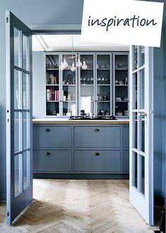 The color. I like how painting everything that grayish blue looked so sophisticated and bespoke.    The glass-front cabinets. They remind me of something you'd see in an old library.    The floors. Herringbone is a subtle hit of pattern and different from the usual dark wood planks so popular right now.    The light fixture. It's the surprise in the room, like some glam version of Tinker Toys.