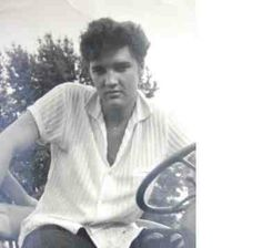 rare: Elvis on his tractor