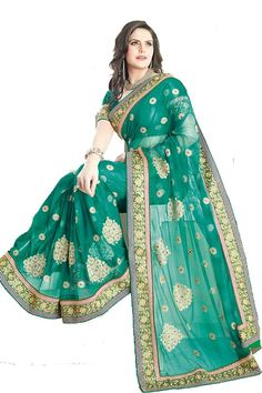 Beguiling Green Net Saree  Fabric: NetColor: Green More details  Reference : VLR5797 http://valehri.com/sarees/441-beguiling-green-net-saree.html