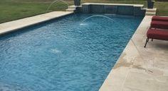 formal-pool-leuder-coping-sunstone-marina-cay-plaster-dark-walnut-travertine-pavers-raised-wall-with-glass-tile-sheer-descents-tanning-ledge-deck-jets