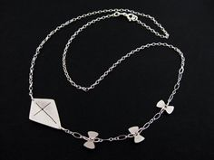 Sterling Silver Kite Necklace with Tiny Bow Kite by OffbeatMelody, $49.00