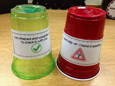 Use cups to signal when you need help or a check so kids aren't wasting time sitting with their hand sin the air