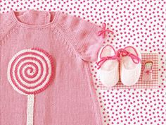 Knitted baby dress with a crochet lollipop - Tenderblue