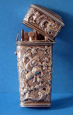 Mid 18th cent Georgian Silver Etui Necessaire, circa 1760. The front and back of the tapering case richly decorated with various musical instruments amidst a foliage and stippled background. The interior is fitted with 11 original implements, including fork, 2 knives, measure ruler, scissors, ivory leaves, snuff spoon, tweezers, file, needle threader.; one compartment vacant, presumably for pencil. Inscribed on top cover H. Lamley in script. Height: Approx 3.75 inches.