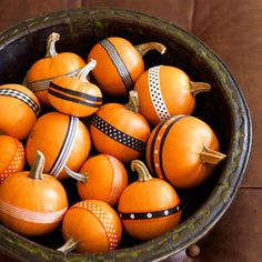 Halloween/Fall centerpiece idea: wrap ribbon around small pumpkins - cute and easy. Could make this into a new Halloween tradition. Instead of carving pumpkins, get ribbon scraps and buttons and things together, and decorate small pumpkins. Mini Pumpkins, Halloween Pumpkins, Halloween Crafts, Halloween Decorations, Small Pumpkins, Pumpkin Decorations, Halloween Ribbon, Pumpkin Centerpieces, Halloween Table