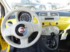 New 2015 FIAT 500 Pop for sale in St Louis Park MN at Luther Fiat of Minneapolis. 2015 Fiat 500 hatchback for sale Minneapolis in Giallo Moderna Perla (Pearl Yellow TC). Yellow Fiat 500 for sale Minnesota. Twin Cities. 2015 Fiat 500 Pop interior.