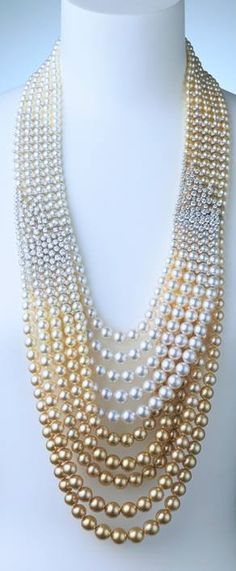 Mikimoto multi pearl necklace... the graduating color and diamonds are fab!