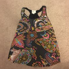 Printed tank Razor-back styled tank with a beautiful print. Tops Tank Tops