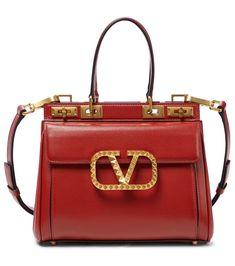 Valentino Garavani - Rockstud Alcove Medium leather tote | Mytheresa Medium Tote, Short Tops, Valentino Garavani, Hermes Kelly, Calf Leather, Alcove, Dust Bag, Shoulder Strap, Luxury Fashion