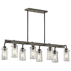 Embodying the restoration aesthetic, the Kichler Braelyn Linear Suspension offers a reclaimed industrial statement. On either side of a flat rail, Clear Seedy glass shades reminiscent of 19th-century kitchen jars are suspended from Olde Bronze finished sockets. Enhance the authenticity of this look with Edison-style bulbs, whose prominent filaments add a decorative touch as well as providing warm light.