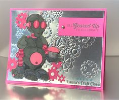 Double the use of your dies by embossing instead of cutting with them. This Pink Robot has a silver foil background of gears embossed with dies. Learn the Embossing with dies onto foil Technique! Robot Background, Unicorn Challenge, Craft Stash, Foil Paper, Foil Art, Digi Stamps, Emboss, Paper Goods, Pretty In Pink