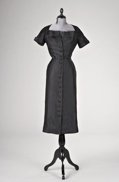 """Dress (Part of Suit), Christian Dior, Paris, France: 1949, narrowly-corded silk faille. """"The suit was commissioned by Wallis Simpson, the Duchess of Windsor, from Christian Dior, Paris, in 1949. Two sketches and one model photograph from the Dior Archives identify a very similar outfit from spring/summer 1949. The suit with its separate narrow and wide skirts exemplifies the twin silhouettes of the 'New Look' and meant that the Duchess could produce different looks with the same bodice."""""""