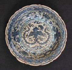 Dish with Phoenixes Made in Possibly Syria , late century Earthenware; painted under transparent glaze, D. 34 cm Metropolitan Museum of Art, New York, Ceramic Bowls, Ceramic Pottery, Ceramic Art, Ancient Persian, Reception Rooms, Illuminated Manuscript, Metropolitan Museum, Earthenware, Decoration