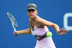 Maria Sharapova of Russia plays a forehand during her women's singles first round match against Melinda Czink of Hungary on Day One of the 2012 US Open