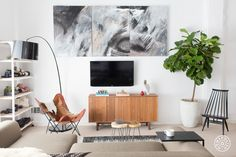 A Photographer's SF Loft Redesign - Almost everything was changed in Helena's space. She and Savannah kept the recently purchased sofa, painted the walls a bright white and sourced classically beautiful mid-century pieces. - @Homepolish San Francisco