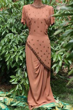 Sultry, shapely beaded 1940s floor length gown,  copper metallic beads, brown crepe, peplum,copper colour crepe.