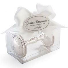 A special gift for the new baby!  This silver-plate rattle features an embossed cross and beading. Comes in gift box as shown.  Visit littleorangefishkids.com for more information or give us a call.