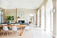 Love the open space, bright light with big windows, farm table with modern chairs