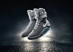 "The self-lacing sneakers, the Nike Air Mag II, will debut next spring. Michael J Fox, who played Marty McFly in ""Back to the Future II"" got the first pair. Nike Air Mag, Photo Basket, Tie Shoes, Men's Shoes, Nike Font, Yeezy, Reebok, Air Max Sneakers, Adidas Sneakers"