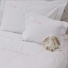 Bunnies baby pillowcase with hand embroidery on the top left corner. Available in blue and pink. Matching cot bed duvet...