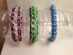 Three rainbow loom bracelet creations...the infinity, the dragon scale, and the hexafish. $2.00 per rubberband bracelet.  $5.00 shipping on one total order.  Fifteen colors to chose from (red, light orange, green, light green, yellow, light purple, dark purple, pink, dark pink, gray, white, black, blue, light blue, and aqua.  When ordering, state colors you would like in your Bracelet.  Email me at jalexiou974@yahoo.com.