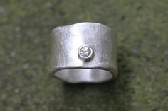 Silver wide ring textured + diamond... my kind of engagement ring (SaaraReidsema - Etsy - $240)