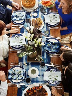 Create a festive holiday table -- complete with pretty Hanukkah centerpieces, napkin ideas, and decor in traditional blue and white -- for your Hanukkah celebration. A little time spent setting the table makes the Hanukkah fe