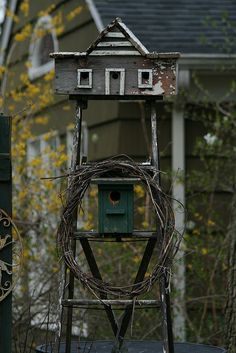 birdhouses on old ladder