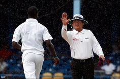 Don't know what Umpire Ian Gould is trying to explain West Indian Pacer .... !!
