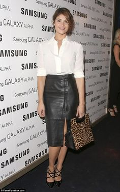 Lovely in leather: Gemma Arterton looked chic in a white blouse and black split skirt at the event