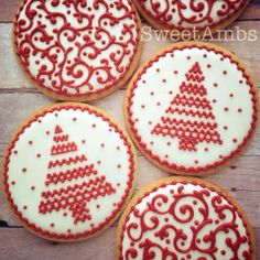 Red and white decorated Christmas cookies. Reminds me of Finland or Sweden holiday decorations. Galletas Navidad. Iced biscuits.