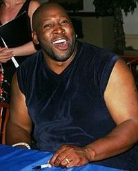 Wayman Tisdale ~ An American professional basketball player in the NBA and a smooth jazz bass guitarist.