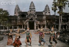 Cambodia 1931 1931, Angkor Vat, Siem Reap, Cambodia --- Thespians perform in proper posture before Angkor Wat --- Image by © W. Robert Moore/National Geographic Society/Corbis