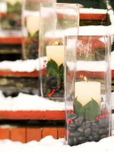 Outdoor Holiday Decorations: ~~~ Leafy Luminarias ~~~ Cylindrical glass vases light the way when filled with river rocks, magnolia leaves, red winterberries, and long-lasting pillar candles. Simple Christmas, Winter Christmas, Christmas Home, Christmas Crafts, Nordic Christmas, Modern Christmas, Best Outdoor Christmas Decorations, Christmas Candles, Christmas Topiary